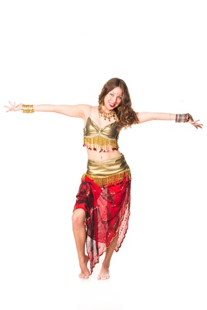 Beautiful eastern belly dancer isolated on white photo