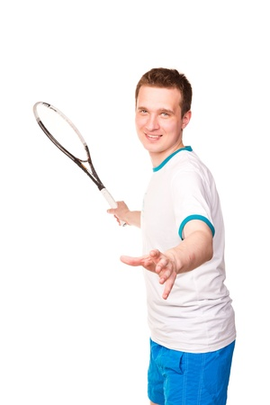 Sportive young man playing tennis isolated on white photo