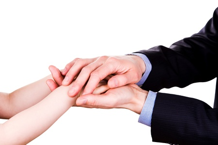 Child holding fathers hand isolated on white. Trust, togethterness and support concept. photo