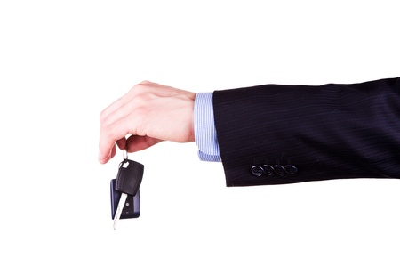 Male hand holding a car key isolated on white background  New car concept Stock Photo - 18705871