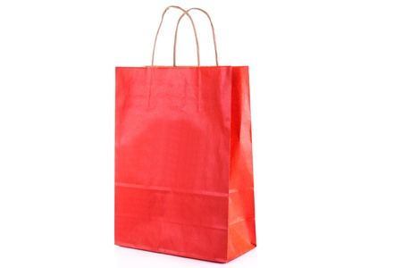Red paper shopping bag isolated on white  Shopping concept  photo