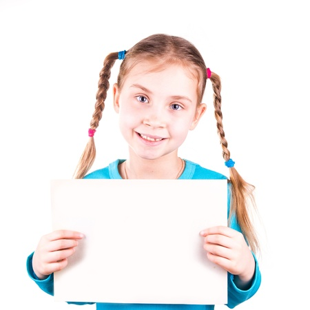 Smiling little girl holding an empty white card for you sample text isolated on white photo
