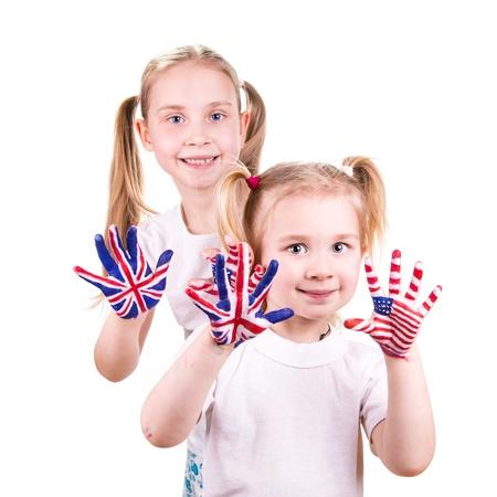 drapeau anglais: Drapeaux am�ricains et anglais sur l'enfant Banque d'images