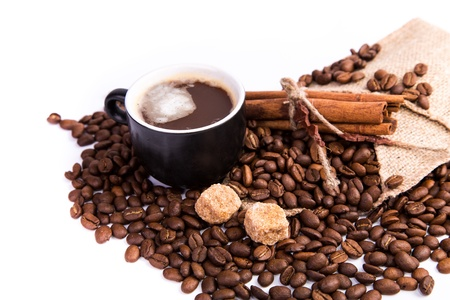 Coffee with coffee beans, cinnamon sticks, white and brown sugar isolated on white photo