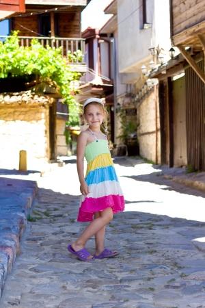 bulgaria girl: Beautiful little girl in ancient street of the Nesebar, the ancient city on the Black Sea coast of Bulgaria