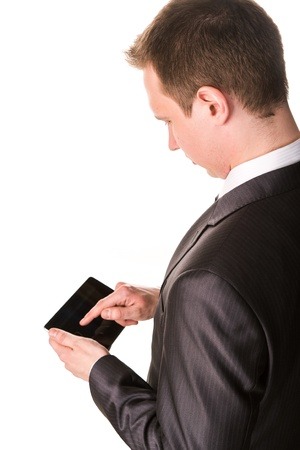 Young businessman working on a tablet pc comuter isolated on white photo
