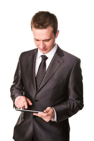 Young businessman working on a tablet pc comuter isolated on white Stock Photo