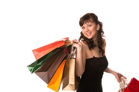Beautiful happy woman with many shopping bags isolated on white  Shopping concept  photo