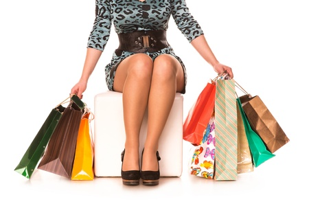 Woman legs in highheels with many shopping bags isolated on white background  Shopping concept Stock Photo - 18784353