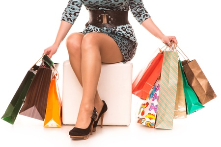 beautiful legs: Woman legs in highheels with many shopping bags isolated on white background  Shopping concept