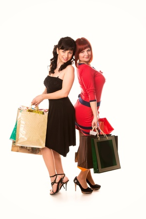 Beautiful happy girls with many shopping bags isolated on white  Shopping concept Stock Photo - 18838048