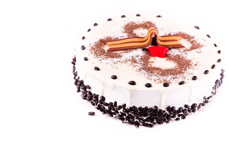 Tasty coffee chocolate cake with George ribbon as Second World War Victory sign isolated on white photo