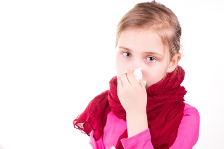 Sick little girl  sneezing with napkin isolated on white