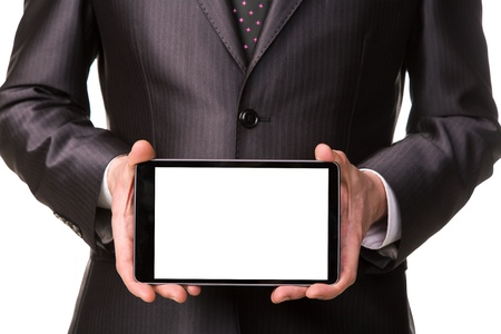 Businessmans hand showing a tablet pc comuter with blank screen for your sample text isolated on white photo