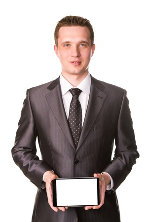 Young businessman showing a tablet pc comuter with blank screen for your sample text isolated on white Stock Photo - 19062928