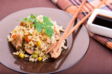 Rice with vegetables and mushrooms with soy sauce served photo