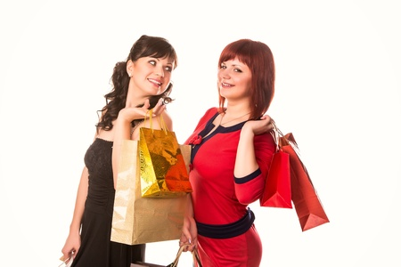 Beautiful happy girls with many shopping bags isolated on white. Shopping concept. photo