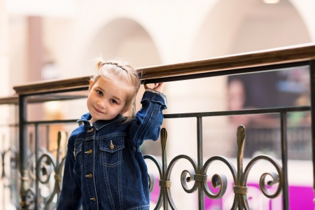 Cute little child in shopping center posing photo