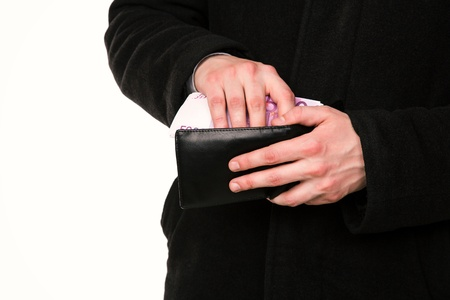 Businessman hands counting money in his wallet isolated on white photo
