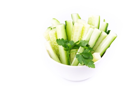 Fresh cucumber ready to eat served on a plate isolated on white photo
