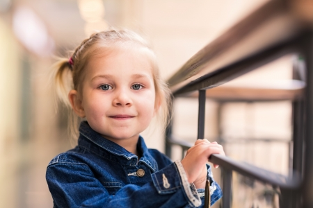 view of a staircase in a shop: Cute little child in shopping center posing Stock Photo