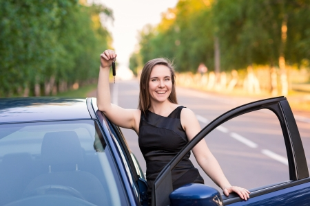 Beautiful businesswoman near her car on the road photo
