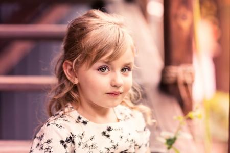 Charming little girl in a beautiful dress in a park outdoor Reklamní fotografie