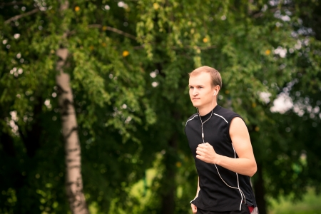 Sportive young man runner jogging at great speed on a road Reklamní fotografie - 21285000