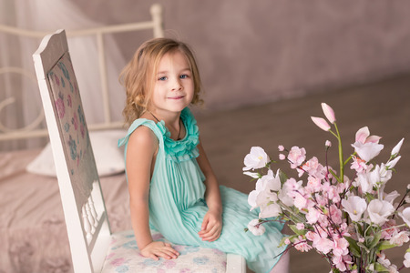 Cute little girl in fashion dress with spring flowers photo