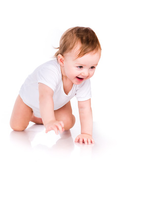 Cute little baby crawling isolated on white Stock Photo