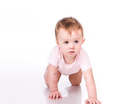 baby crawling: Cute little baby crawling isolated on white Stock Photo