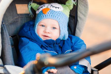 young bird: Cute little baby in a stroller outdoor
