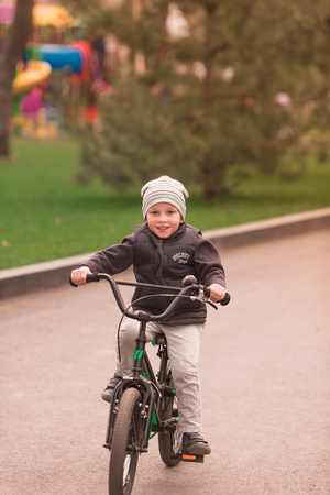 Happy four years old boy learning how to ride a bike. First riding lessons