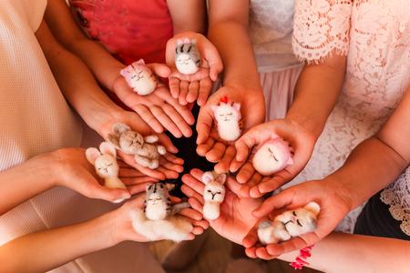 Kidss hands holding felted toys. Handmade and creativity concept Reklamní fotografie