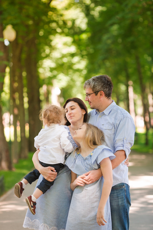 Happy family with two kids enjoying time in the park