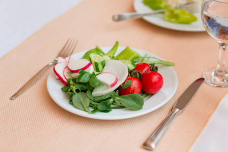Fresh health organic vegetables on a plate. Healthy diet, nutrition and vegetarian food concept