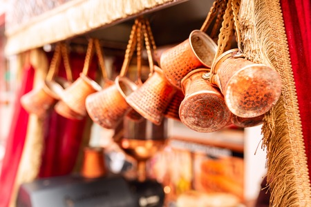 Close up of a bunch of copper coffee jezve pots hanged up in a market in Istanbul, Turkey Reklamní fotografie