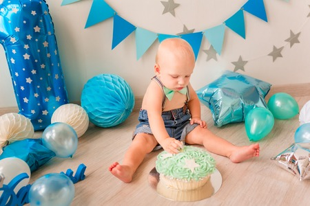 Adorable baby boy celebrating his first birthday. Smash cake party Reklamní fotografie - 120538618