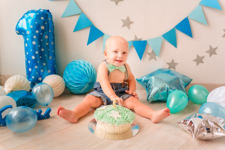Adorable baby boy celebrating his first birthday. Smash cake party Reklamní fotografie - 120538634