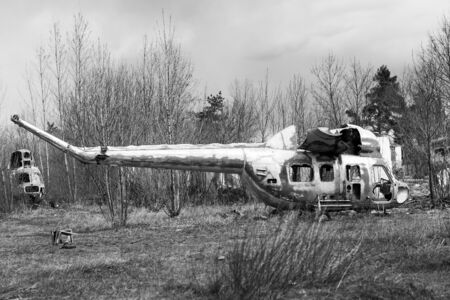 Old destroyed Soviet abandoned military airplanes in the field in Ukraine, black and white. Former soviet aviation wreckage after second world war
