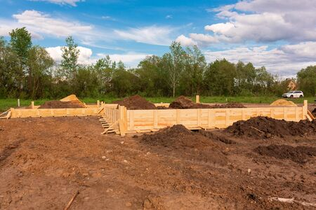 Wooden formwork for creating strip foundation for new house basis. Constructing house from the beginning concept Stock fotó