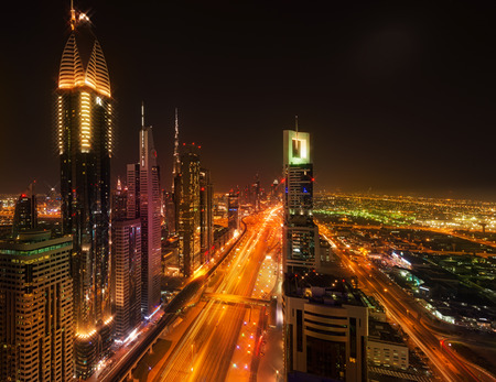city by night: DUBAI, UAE - SEPTEMBER 3, 2014: Sheikh Zayed Road by night, Dubai (United Arab Emirates) Editorial