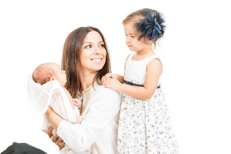 beautiful mother: Happy mother with daughter and newborn baby  isolated