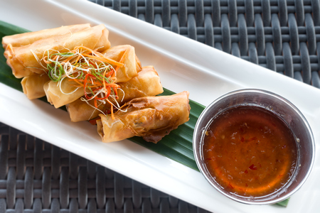 abreast: Vegetable fried spring rolls served with bittersweet sauce Stock Photo