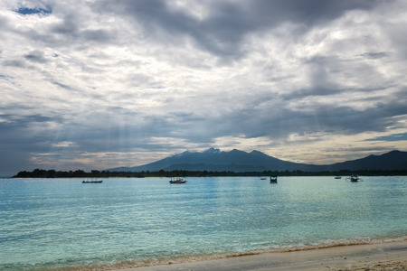 Tropical sea with dramatic sky.Sun rays shining through the clouds