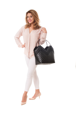 Beautiful woman with black wicker tote bag.Isolated on the white studio background