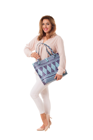 Pretty woman with bright wicker tote bag.Isolated on the white studio background