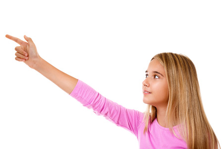 Attractive  young girl pointing her finger. White background Stock Photo