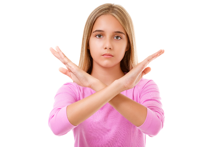 Picture of young teen girl making stop gesture-white background