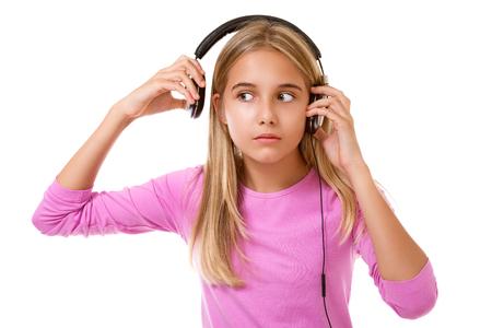 Lovely teenage girl removing her headphones for noise or loud music  over white  background